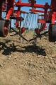 Weed control with a fingerweeder and a driven harrow